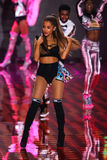 LONDON, ENGLAND - DECEMBER 02: Singer Ariana Grande performs on the stage during the 2014 Victoria's Secret Fashion Show Royalty Free Stock Photo