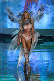 LONDON, ENGLAND - DECEMBER 02: Singer Hozier performs on the stage as model Candice Swanepoel walks the runway Stock Image