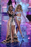 LONDON, ENGLAND - DECEMBER 02:  Singer Taylor Swift (L) perfoms on stage as model Sigrid Agren (R) model walks the runway Royalty Free Stock Photos