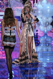 LONDON, ENGLAND - DECEMBER 02: Singer Taylor Swift (L) perfoms on the stage as model Sigrid Agren (R) walks the runway Stock Photo