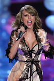 LONDON, ENGLAND - DECEMBER 02: Singer Taylor Swift perfoms on the runway during the 2014 Victoria's Secret Fashion Show Royalty Free Stock Photos