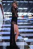 LONDON, ENGLAND - DECEMBER 02: Singer Taylor Swift performs on the runway during the 2014 Victoria's Secret Fashion Show Stock Photos