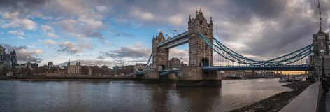 LONDON, ENGLAND, DECEMBER 10th, 2018: Tower Bridge in London, the UK. Sunrise with beautiful clouds. Panoramic view with royalty free stock photography