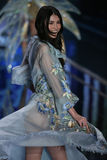 LONDON, ENGLAND - DECEMBER 02: Victoria's Secret model Sui He walks the runway Stock Images