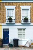 London, England, Europe - characteristic English house with white and brick wall. And blue door Royalty Free Stock Photo