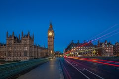 London, England - The famous Big Ben and Houses of Parliament with lights of double decker buses Stock Images