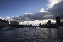 Dark skies over Westminster Bridge seen from the River Thames, London, England, February 12,. LONDON, ENGLAND - FEBRUARY 12, 2018. Dark skies over Westminster royalty free stock photo