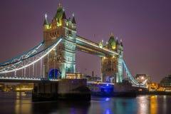 London, England - Iconic illuminated Tower Bridge by night. With purple sky Stock Photography