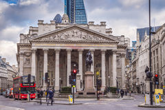 London, England - Iconic red double decker bus and the Royal Exchange building Royalty Free Stock Photo
