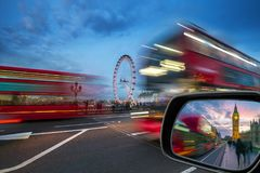 London, England - iconic red double-decker buses on the move on Westminster Bridge with Big Ben and Houses of Parliament Stock Photo