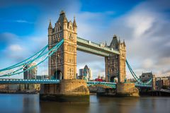 London, England - Iconic Tower Bridge with traditional red double-decker bus and skyscrapers. Of Bank District at background Royalty Free Stock Image