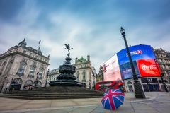 London, England - 03.18.2018: Iconic Union Jack umbrella at the empty Piccadilly Circus in the morning Stock Photos
