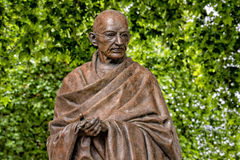 LONDON, ENGLAND - JULY 15 2017 - ghandi statue in london. LONDON, ENGLAND - JULY 15 2017  - ghandi statue in london town one of most visited in city attractions Royalty Free Stock Photography