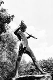 Hyde Park, one of the largest parks in London. LONDON, ENGLAND - JULY 23, 2016: Peter Pan statue in the Kensigton Gardens. Peter Pan is a fictional character Stock Images