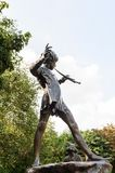 Hyde Park, one of the largest parks in London. LONDON, ENGLAND - JULY 23, 2016: Peter Pan statue in the Kensigton Gardens. Peter Pan is a fictional character Royalty Free Stock Photos