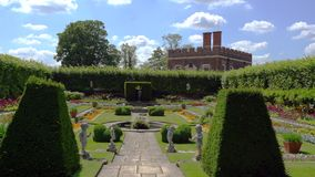 Hampton Court Palace immaculate garden with blue sky and clouds stock video