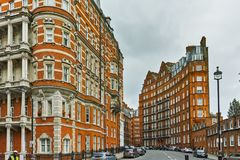 Amazing view of typical English building, London, Great Britain. LONDON, ENGLAND - JUNE 18 2016: Amazing view of typical English building, London, Great Britain Royalty Free Stock Photography