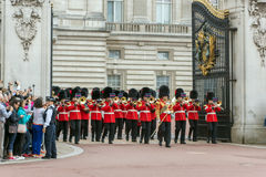 LONDON, ENGLAND - JUNE 17 2016: British Royal guards perform the Changing of the Guard in Buckingham Palace, London, Grea Royalty Free Stock Image