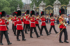 LONDON, ENGLAND - JUNE 17 2016: British Royal guards perform the Changing of the Guard in Buckingham Palace, London, Grea Stock Photography