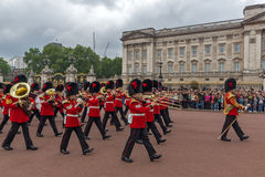 LONDON, ENGLAND - JUNE 17 2016: British Royal guards perform the Changing of the Guard in Buckingham Palace, London, Grea Royalty Free Stock Photo