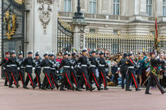 LONDON, ENGLAND - JUNE 17 2016: British Royal guards perform the Changing of the Guard in Buckingham Palace, London, Grea. LONDON, ENGLAND - JUNE 17 2016 royalty free stock photos