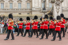 LONDON, ENGLAND - JUNE 17 2016: British Royal guards perform the Changing of the Guard in Buckingham Palace, London, Grea. LONDON, ENGLAND - JUNE 17 2016 royalty free stock photography