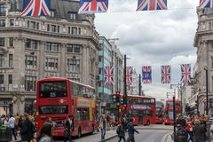 LONDON, ENGLAND - JUNE 16 2016: Clouds over Oxford Street, London, England, Great Britain. LONDON, ENGLAND - JUNE 16 2016: Clouds over Oxford Street, City of Stock Images