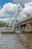 LONDON, ENGLAND - JUNE 15 2016: Hungerford Bridge and Thames River, London, United Kingdom Royalty Free Stock Photo