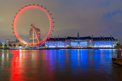 LONDON, ENGLAND - JUNE 16 2016: Night photo of The London Eye and County Hall, London, England Stock Photos