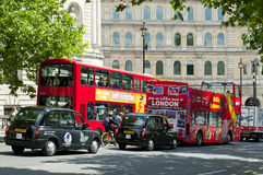 London. ENGLAND - MAY 30:  double-decker buses and black taxi cabs in the city center on May 30, 2015 in Royalty Free Stock Photo
