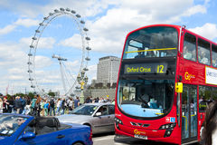 London. ENGLAND - MAY 30:  Eye and double-decker bus in the city center on May 30, 2015 in stock photography