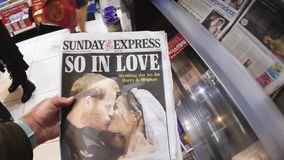 International Uk Newspaper about Royal Wedding. London, England - May 20, 2018: POV The Sunday Express front cover newspaper British press kiosk featuring stock video