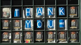 A London restaurant displays Thank You NHS posters in the front window. Pan upwards to window.