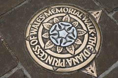 Metal plaque in the pavement, marking the Princess Diana Memorial Walk in London. England royalty free stock photo