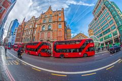 Fish-eye view with red double decker bus. LONDON, ENGLAND - NOVEMBER 27, 2017: Fish-eye view with red double decker bus and people on the street. Old and new Stock Photography