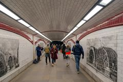Inside view of one London Underground station with pictures on t. LONDON, ENGLAND - NOVEMBER 28, 2017:  Inside view of one London Underground station with Royalty Free Stock Photography