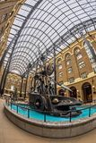 The Navigators, a sculpture by David Kempton in Hays Galleria. LONDON, ENGLAND - NOVEMBER 27, 2017: The Navigators, a sculpture by David Kempton in Hays Galleria Royalty Free Stock Photography