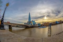 Shard Tower and the banks of Thames river below London Bridge. LONDON, ENGLAND - NOVEMBER 27, 2017: Overlooking the Shard Tower and the banks of Thames river Stock Photo