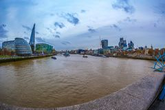 Panoramic view over London from the Tower Bridge. LONDON; ENGLAND - NOVEMBER 27; 2017: Panoramic view over London from the Tower Bridge to the City Hall; the royalty free stock image