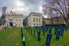 Symbolic graveyard with flags in front of the Maritime Museum, L. LONDON, ENGLAND - NOVEMBER 29, 2017: Symbolic graveyard with flags, in front of the Maritime Stock Photography