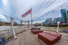 View from one ship with British flag on Thames river. LONDON, ENGLAND - NOVEMBER 27, 2017: View from one ship with British flag on Thames river. Skyscraper on Stock Image