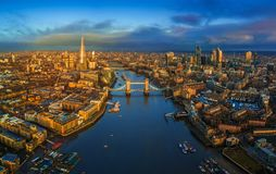London, England - Panoramic aerial skyline view of London including iconic Tower Bridge with red double-decker bus. Tower of London, skyscrapers of Bank stock images