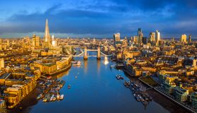 London, England - Panoramic aerial skyline view of London including iconic Tower Bridge with red double-decker bus. Skyscrapers of Bank District and other royalty free stock photos