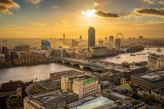 London, England - Panoramic aerial skyline view of London at sunset with Blackfriars bridge. Over River Thames, skyscrapers and other famous landmarks stock image