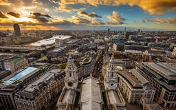 London, England - Panoramic aerial skyline view of London taken from the top of St.Paul`s Cathedral. At sunset with dramatic clouds royalty free stock image