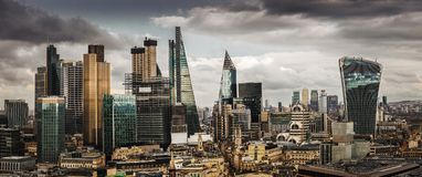 London, England - Panoramic skyline view of Bank and Canary Wharf, central London`s leading financial districts. With famous skyscrapers and other landmarks at royalty free stock photography