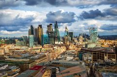 London, England - Panoramic skyline view of Bank and Canary Wharf, London`s leading financial districts. With famous skyscrapers and other landmarks at golden royalty free stock photo