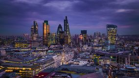 London, England - Panoramic skyline view of Bank district of London. With the skyscrapers of Canary Wharf at the background at blue hour stock photography