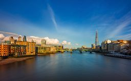 London, England - Panoramic skyline view of central London with skyscrapers of Bank district, River Thames. Tower Bridge and other famous landmarks at sunset stock images