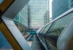 London, England - Public pedestrian cross rail footbridge at the financial district of Canary Wharf. With skyscrapers Royalty Free Stock Image